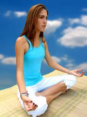 yoga girl - meditation in cloudscape background