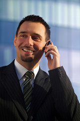attractive young businessman on cellphone