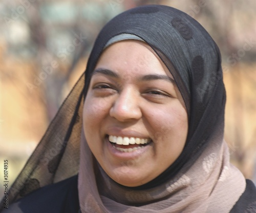 smiling muslim young woman