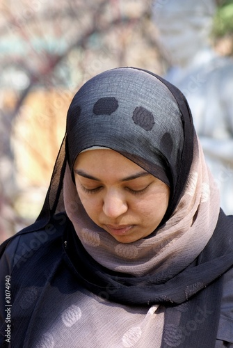 muslim woman with head bowed