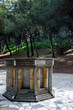 Leinwanddruck Bild - a well in a park in athens, greece