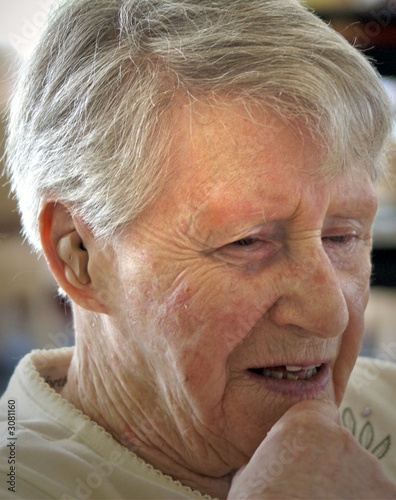 thoughtful elderly woman