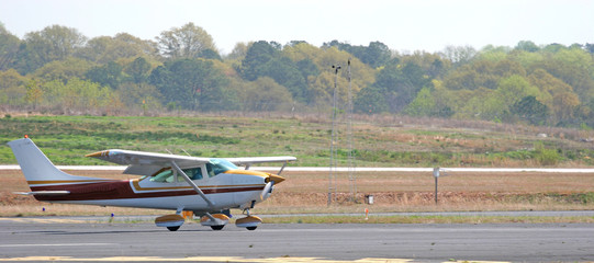 brown and white plane landing