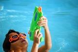 boy wearing orange swim goggles poster