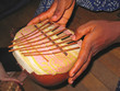 african musical instrument with the musician hands, cameroon, af