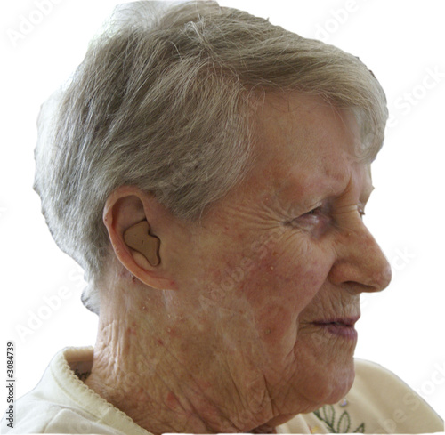 senior woman with hearing aid