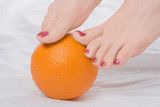 woman legs wth orange poster