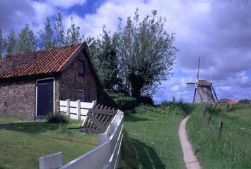 dutch countryside view windmill house barn