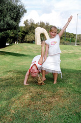 sisters do gymnastic exercises