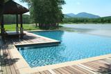 swimming pool in beautiful scenery poster