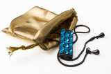 golden gift bag with necklace with blue gems