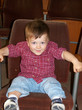 cute baby in cinema chair