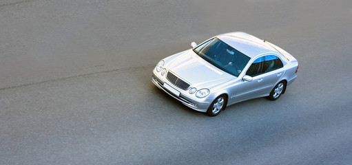 silver luxury german car spped fast on road