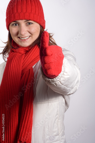 woman thumbs up in winter clothes