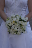 white dress gown flower bouquet poster