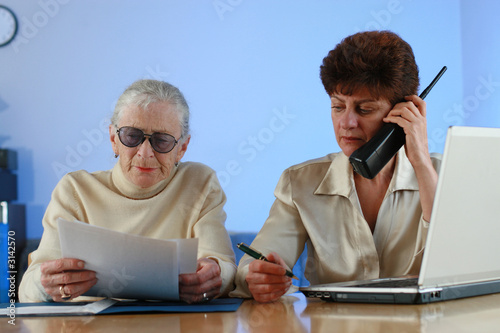 social worker helping senior woman