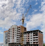 new apartments building construction with crane poster