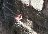 rock climber dangling poster
