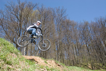 mountain biker jumps from a hill 2