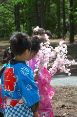children with cherry blossoms