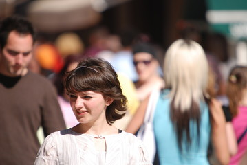 smilling casual girl in crowd