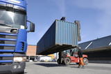 forklift-driver checking hoisted container poster