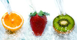 Fototapety fresh fruit jumping into water with a splash