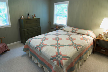 quaint bedroom with bed and quilt