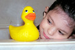 child with her rubber duck