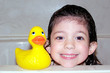 child bath time portrait with rubber duck