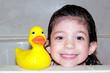 child bath time portrait with rubber duck