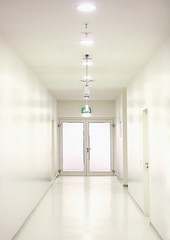 a meticulously clean white corridor