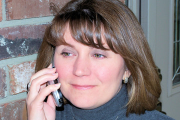 woman talking on cell phone / mobile phone