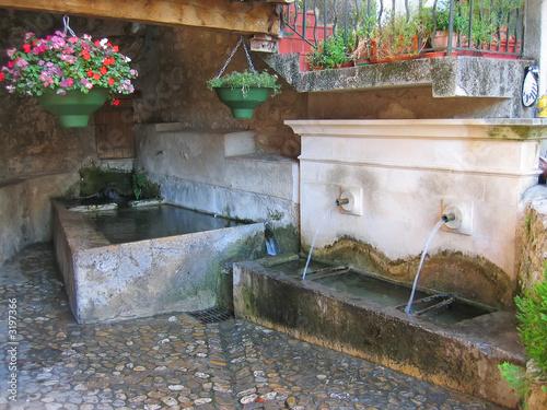 Leinwanddruck Bild water fountain in provencal style, azur coast, south of france