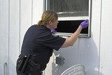 police officer dusting prints poster
