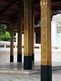 gold pillars at the grand palace in bangkok, thail poster