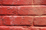 red peeling paint on a brick wall poster