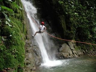 woman rappelling falls