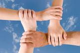 four hands joined together poster