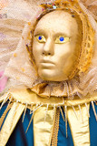 a gold venetian mask with blue eyes poster