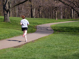 woman jogging in park poster