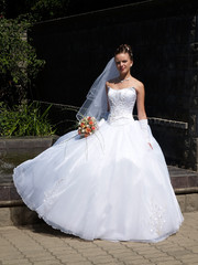 bride with bouquet outdoor