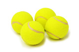 four tennis balls isolated on the white