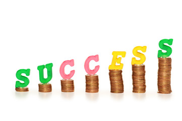 """word """"success"""" on top of coin stacks"""