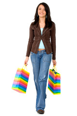 casual girl walking with shopping bags