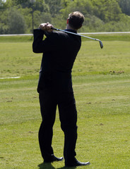 golfer in a suit
