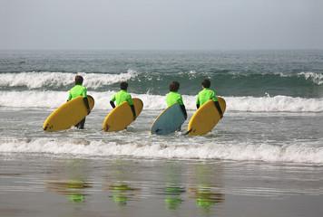 four surfers