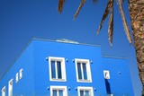 blue hotel with palm tree