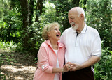 active senior couple with copyspace poster