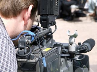 videographer / video camera man
